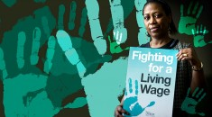 woman holding living wage sign