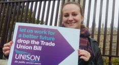 Young woman holds up banner against the Trade Union Bill