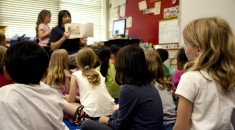 Typical classroom scene where an audience of school children