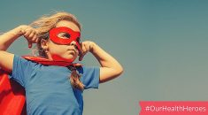 photo of young girl in mask and cape alongisde social media tag #ourhealthheroes