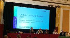 picture of platform at UNISON community seminar with Mark Drakeford speaking at rostrum