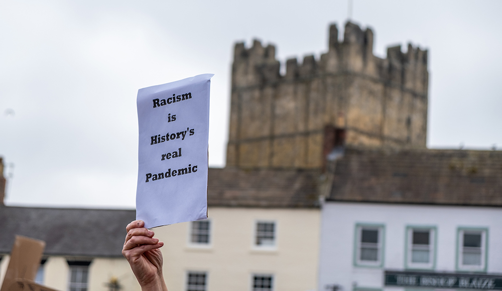 anti-racism message being held by Black hand in Richmond, Yorkshire