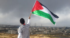 Man waving a Palestinian flag