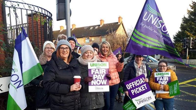 UNISON strikers waving banners